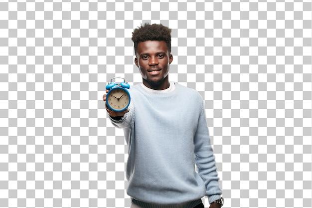 Young black  man with an alarm clock