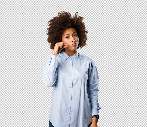 Young black woman doing silence gesture