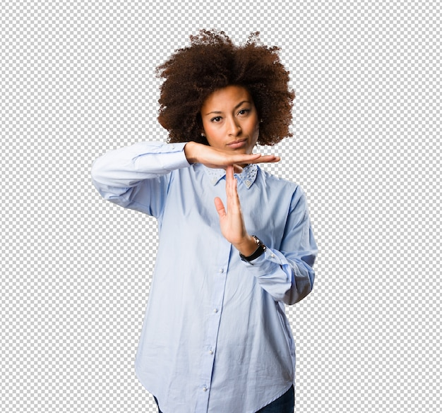Young black woman doing time break gesture