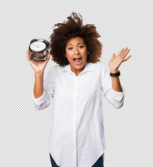 Young black woman holding an alarm clock