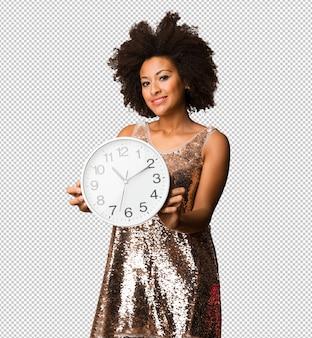 Young black woman holding a big clock