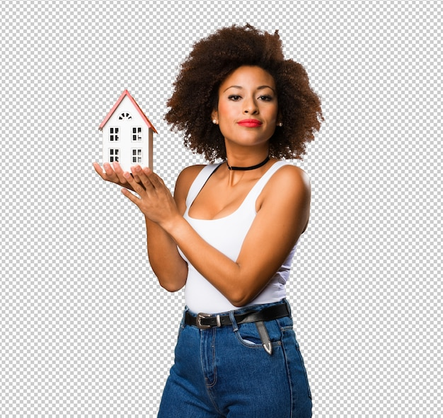 Young black woman holding a small house