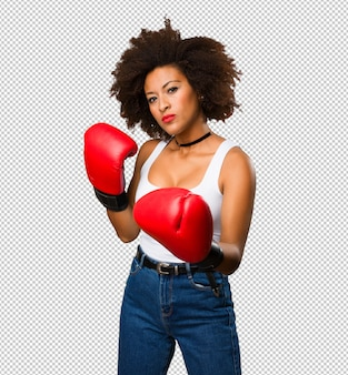 Young black woman using boxing gloves
