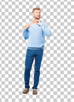 Young blonde man with an anxious, stressed and nervous gesture, feeling under great pressure.