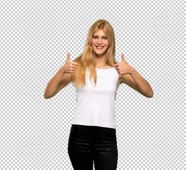 Young blonde woman giving a thumbs up gesture because something good has happened