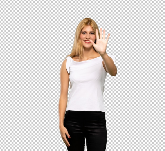 Young blonde woman happy and counting three with fingers