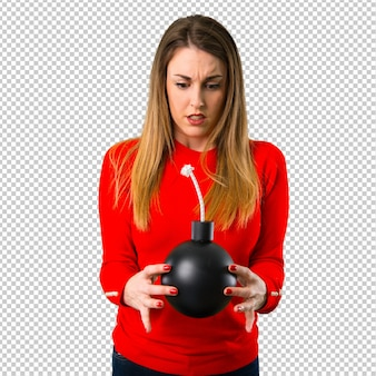 Young blonde woman holding a bomb