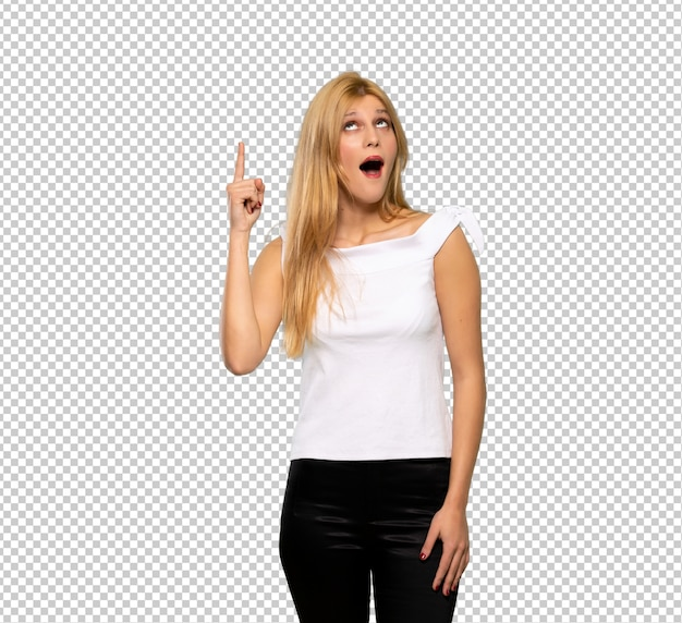 Young blonde woman intending to realizes the solution while lifting a finger up