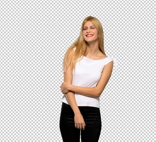 Young blonde woman keeping the arms crossed in frontal position
