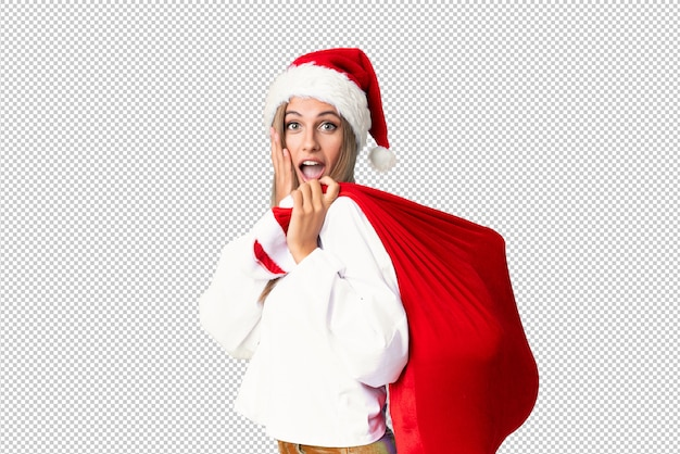 Young blonde woman picking up a bag full of presents