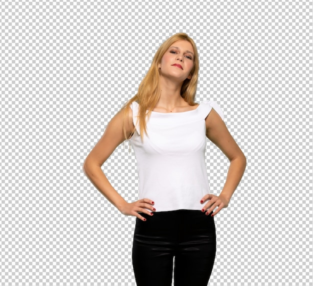 Young blonde woman posing with arms at hip and smiling