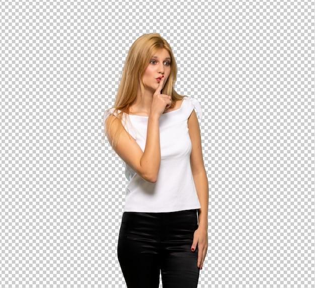 Молодая белокурая женщина показывая знак жеста безмолвия кладя палец в рот