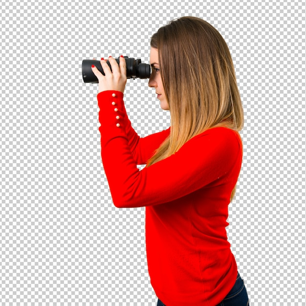 Young blonde woman with binoculars