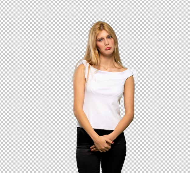 Young blonde woman with sad and depressed expression