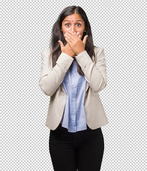 Young business indian woman covering mouth, symbol of silence and repression, trying not to say anything