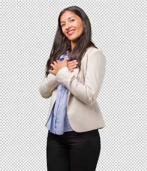 Young business indian woman doing a romantic gesture