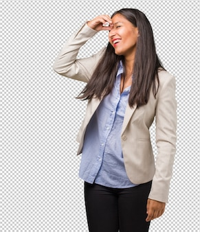 Young business indian woman laughing and having fun, being relaxed and cheerful, feels confident and successful