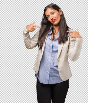 Young business indian woman proud and confident, pointing fingers, example to follow, concept of satisfaction, arrogance and health