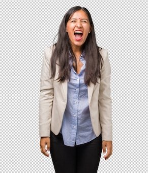 Young business indian woman screaming