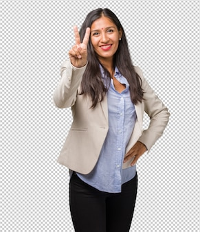 Young business indian woman showing number two, symbol of counting, concept of mathematics, confident and cheerful