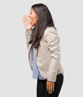Young business indian woman whispering gossip undertone, trying not to be heard