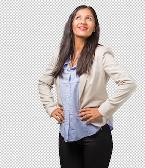 Young business indian woman with hands on hips, standing, relaxed and smiling