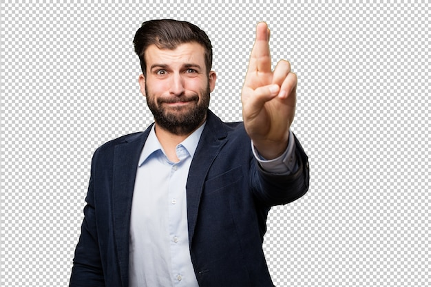 Young businessman finger crossing