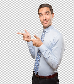 Young businessman pointing with his finger