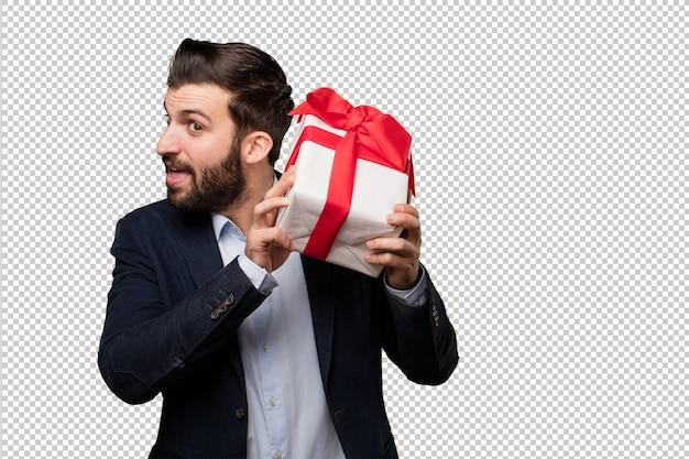 Молодой предприниматель с подарком