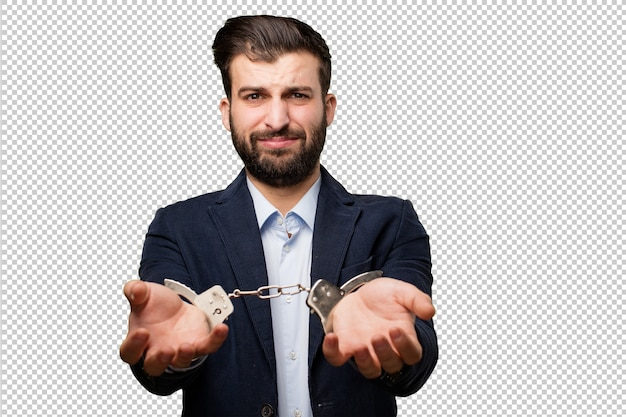 Young businessman with handcuffs