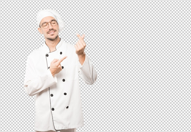 Young chef making a gesture of worried about his economy
