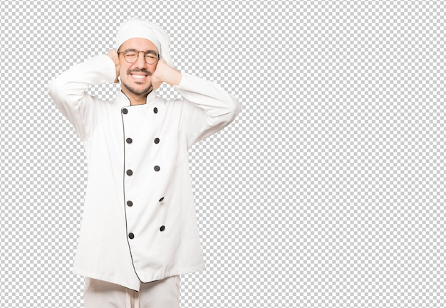 Young chef worried about loud noises and covering his ears