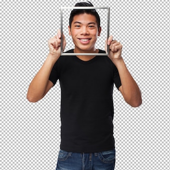 Young chinese man looking through a frame