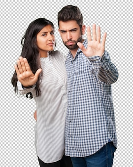 Young couple doing a stop gesture