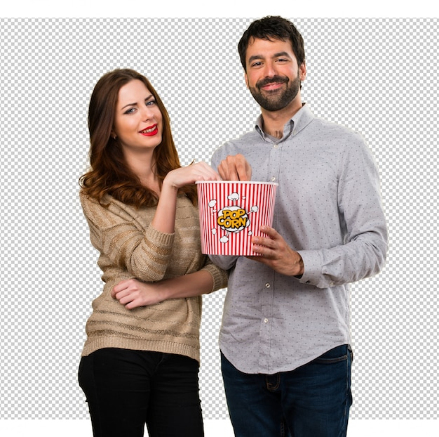 Young couple eating popcorns