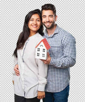 Young couple holding a house
