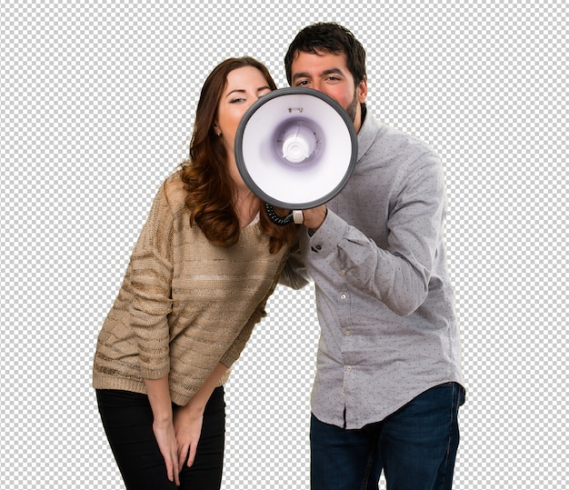 Young couple holding a megaphone