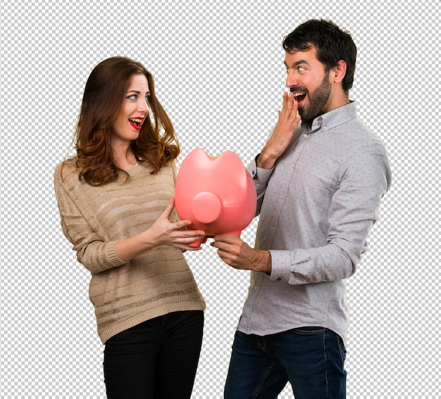 Young couple holding a piggybank