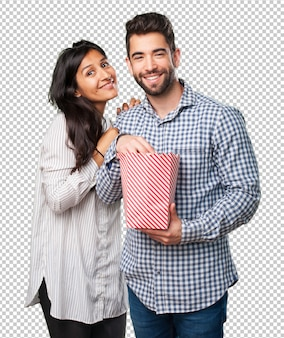 Young couple holding a popcorn