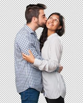 白い背景の上の愛の若いカップル