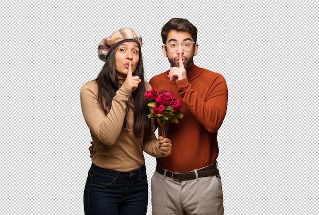 秘密を守るか沈黙を求めるバレンタインデーの若いカップル