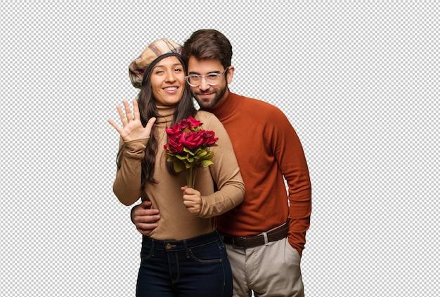 Молодая пара в день святого валентина показывает номер пять