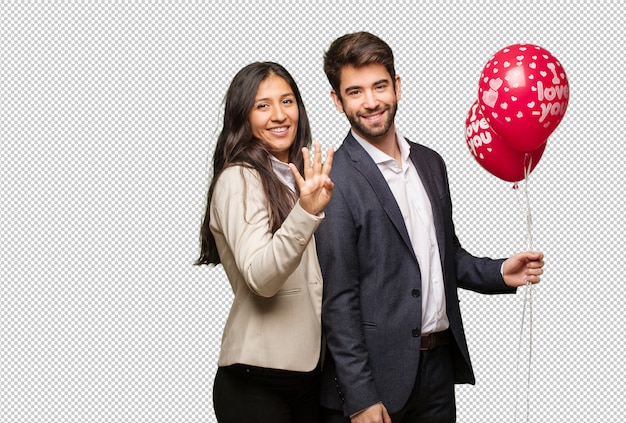 Молодая пара в день святого валентина показывает номер четыре