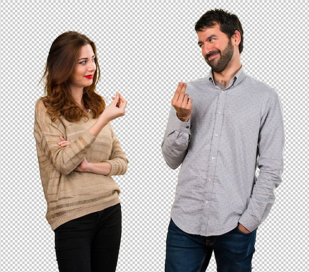 Young couple making money gesture