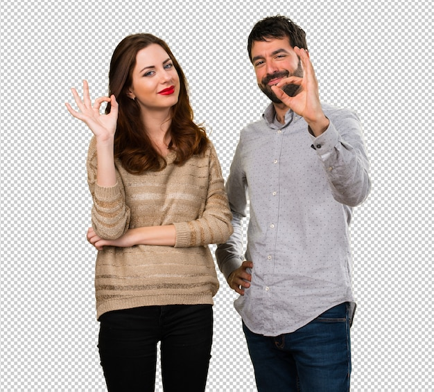 Young couple making ok sign