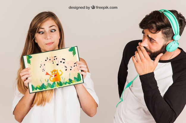 Young couple presenting book