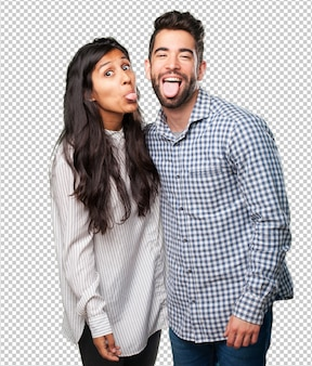 Young couple showing their tongue
