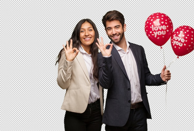 Young couple in valentines day cheerful and confident doing ok gesture