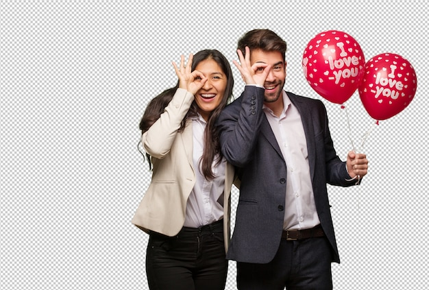 Young couple in valentines day confident doing ok gesture on eye