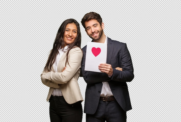 Young couple in valentines day crossing arms, smiling and relaxed